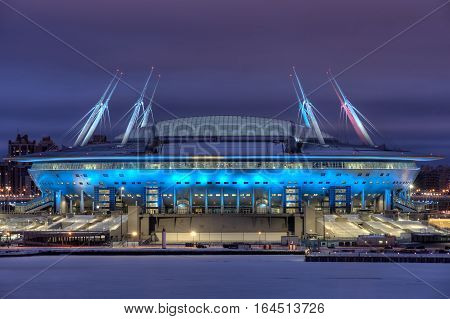 Saint-Petersburg Russia - December 28 2016: Zenit Arena new football Stadium in St. Petersburg for the Soccer World Cup lit up at night.
