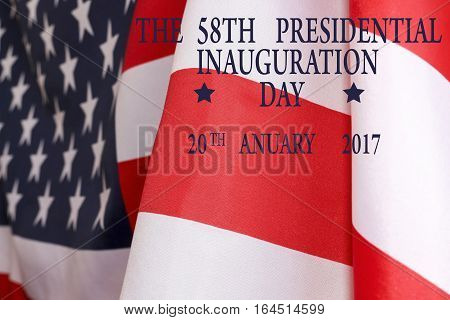 The inauguration of the President background. The text of the 58th presidential inauguration on 20th January 2017 and the US flag.