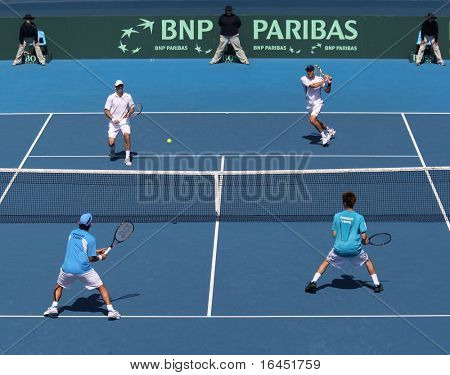 MELBOURNE, AUSTRALIA - MARCH 6: Carsten Ball and Paul Hanley of Australia (top) against Tsung-Hua YANG  and Chu-Huan YI of Chinese Taipei in the Davis Cup tie on March 6, 2010 in Melbourne, Australia