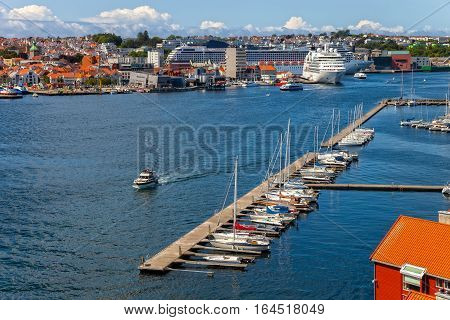 Sailboat marina with many moored sail yachts in the port of Stavanger Norway.