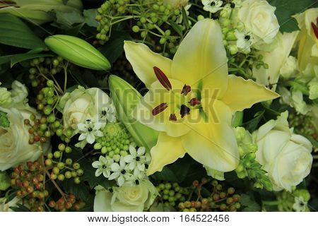 yellow tiger lily in a bridal arrangement