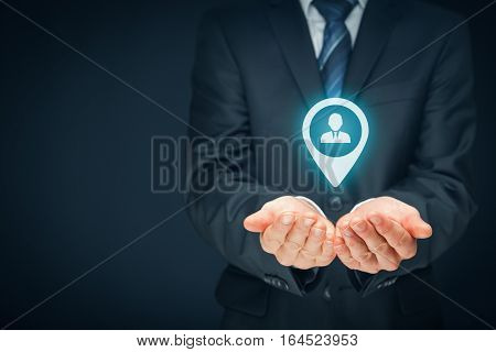 Target customer and human resources (HR) concept. Businessman hold target customer, employee (or another business person) in hand. Right composition.