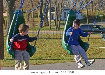 Boys Swinging