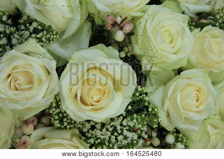 White roses and gypsophila in a bridal bouquet