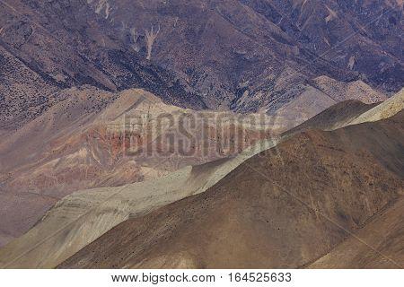 Desert like mountain landscape in the Mustang region Nepal.