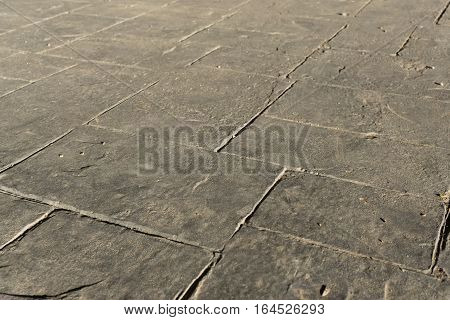 Gray stamped concrete slate seamless texture pattern, pavement outdoor, decorative appearance colors and textures of paving slate stone tile on cement patio design, perspective