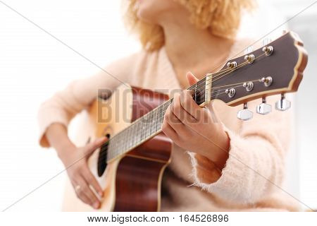 Playing the guitar. Guitar lessons. Acoustic guitar. Relax while playing the guitar.