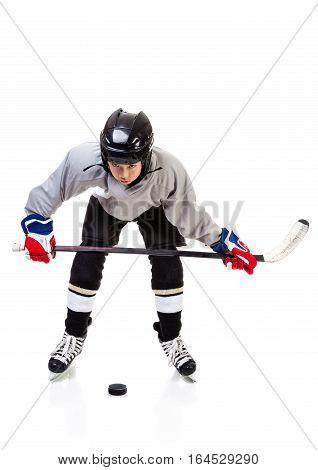 Junior Ice Hockey Player Isolated On White Background