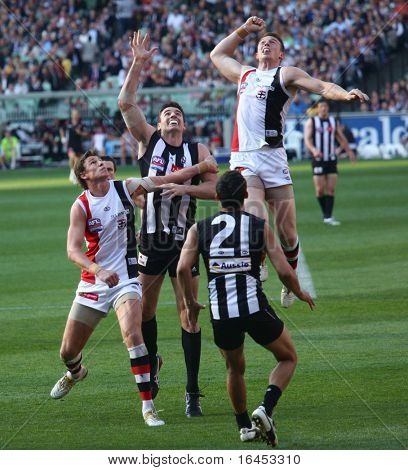 MELBOURNE - OCTOBER 2: St Kilda's Brendon Goddard leaps high over Collingwoods Darren Jolly  during  Collingwood's AFL Grand Final win at the MCG - October 2, 2010 in Melbourne, Australia