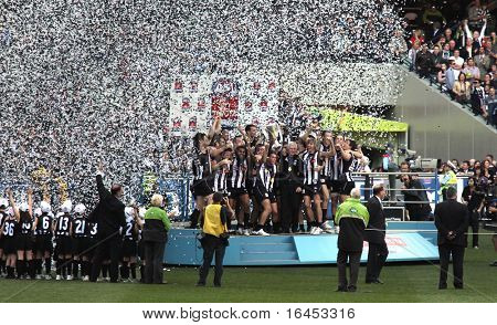 MELBOURNE - OCTOBER 2: Collingwood players celebrate their premiership win over St Kilda in the AFL Grand Final at the MCG - October 2, 2010 in Melbourne, Australia.