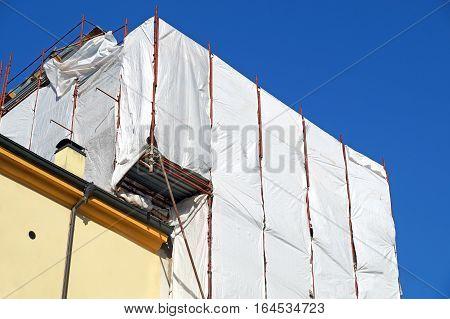 Extensive scaffolding providing platforms for work in progress