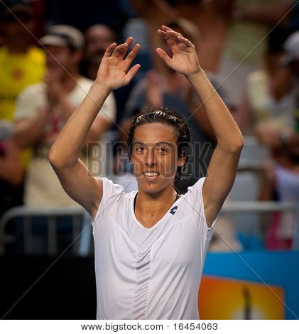 MELBOURNE - JANUARY 23: Francesca Schiavone of Italy celebrates her marathon fourth round win over Svetlana Kuznetsova of Russia in the 2011 Australian Open on January 23, 2011 in Melbourne, Australia
