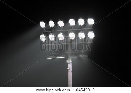 Stadium lights at night in black background