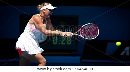 MELBOURNE - JANUARY 23: Caroline Wozniacki of Denmark in her fourth round win over Anastasija Sevastova of Latvia in the 2011 Australian Open on January 23, 2011 in Melbourne, Australia