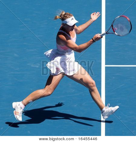 MELBOURNE - JANUARY 27: Caroline Wozniacki of Denmark plays in her semi final loss to Li Na of China in the 2011 Australian Open on January 27, 2011 in Melbourne, Australia