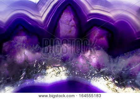 A macro photo of a colorful purple agate stone.  I illuminated it from behind to bring out the interesting mineral textures and bright colors.