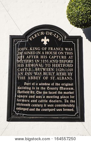 ST. ALBANS UK - JANUARY 5TH 2017: An information plaque marking the location where the Fleur De Lys public house stood and detailing the history of the historic inn in St. Albans on 5th January 2017.