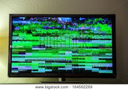 Static tv noise bad TV Digital Video Broadcasting signal on modern lcd plasma tft screen in living room during live transmission live show movie show