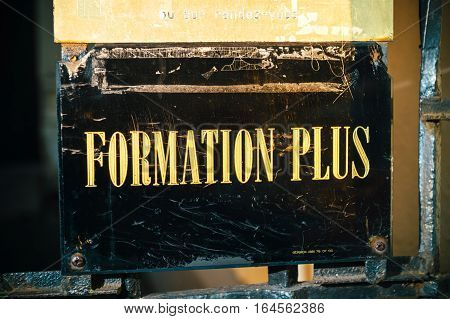 STRASBOURG FRANCE - DEC 1 2016: Formation Plus translating as More Training - inscription with golden letters at the entrance of the bulding
