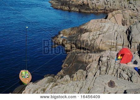Sailing Boat and Tent on the Coast of Norway