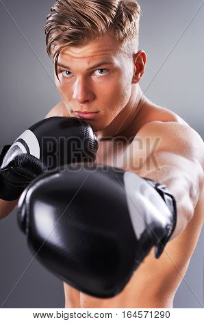 Portrait Of Handsome Muscular Fighter Practicing. Concept Of Healthy Lifestyle