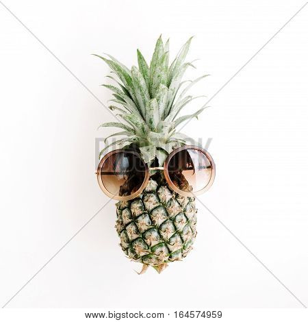 Pineapple in sunglasses. Flat lay top view
