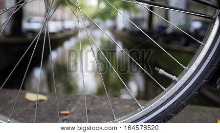 Details of bicycle wheel at Amsterdam canal, Autumn, Netherlands wide angle