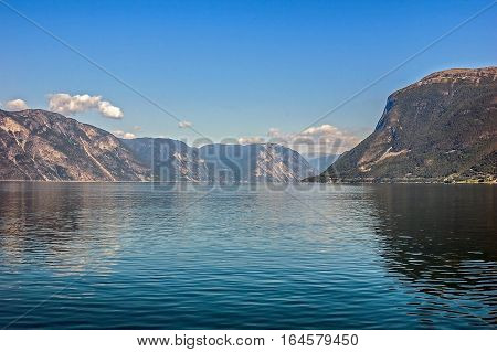 Norway, Geiranger fjord . Clear sunny morning, blue water. Mountains on the shores of the fjord.
