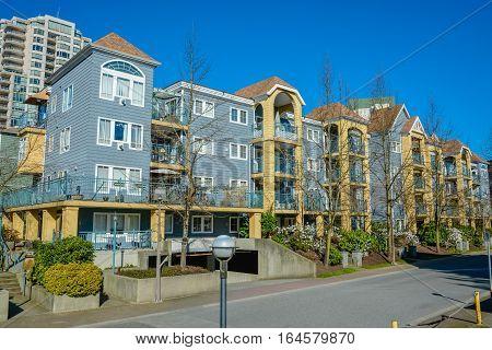 Block of residential buildings on the street. Winter season in Vancouver