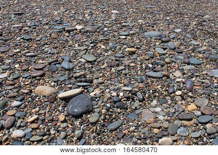 rocks laying on the coastline of an Australian beach