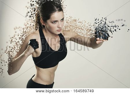 Young Woman Sport Isolated Fight Studio Shot  Disintegrate Into Particles Effects