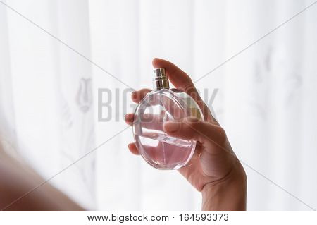 Elegant Bride Holding In Hands A Bottle Of Luxury Perfume