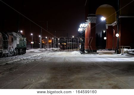 View on railway station with locomotive at winter