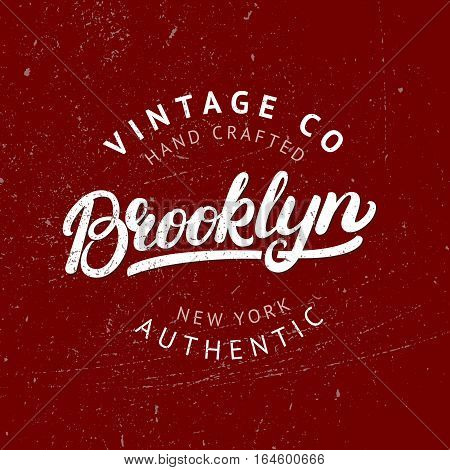 Brooklyn hand written lettering label. College tee print, badge. Vintage style. Grunge texture. Isolated on red background. Vector illustration.
