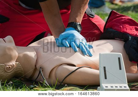 Resuscitation practice with CPR dummy, color image