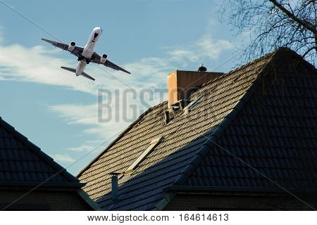 Airplane on departure over a residential area