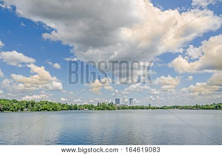 The Public Park Called Herastrau From Romania, Bucharest With Lake, Blue Sky, Clouds, Green Trees.