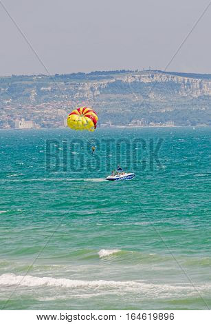 Albena, Bulgaria - June 19, 2016. Colored Parasail Wing Pulled By A Boat In The Blue Water Sea.