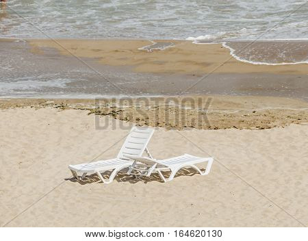 The Black Sea Shore, Two Sun Beds Seaside And Beach With Gold Sands, Blue Water And Waves