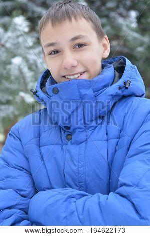 Portrait of a teen boy outdoors in winter
