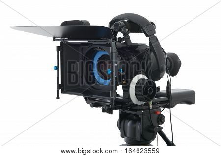 Professional video camera on the white background