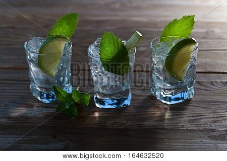 Alcoholic Drink With Lime , Ice  And Peppermint