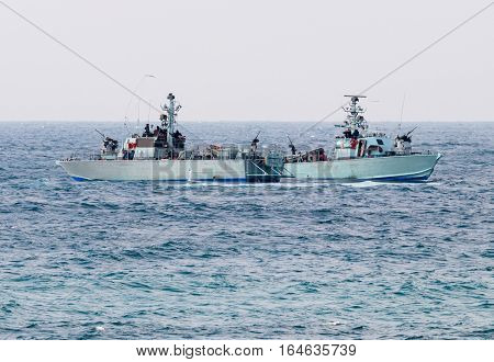 All-weather patrol boats patrol on a cloudy day near the shore of the sea space of the country