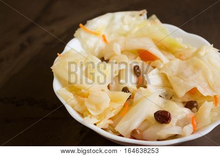 Sauerkraut in a white bowl. Delicious and healthy dishes.