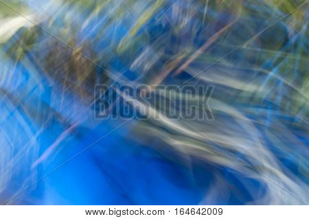 Blurred Abstract Background. Orange Blue And Green.