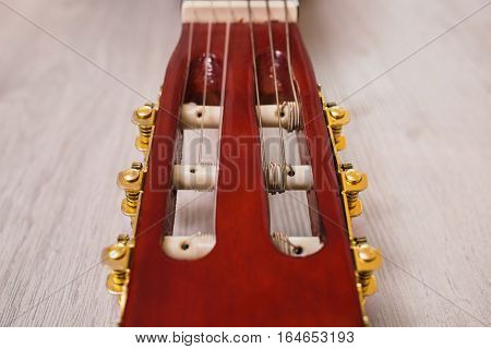 guitar neck on a wooden background musical instrument fretboard