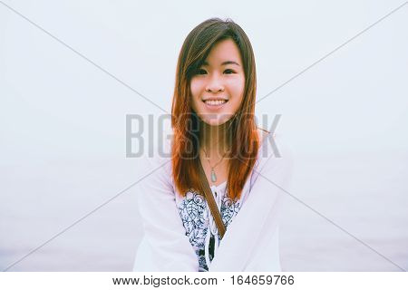 Portrait of Young Asian Woman smiling at the outdoor.