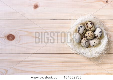 Easter Eggs With Colourfulll Tapes And Bow In Nest Over Wooden Background.
