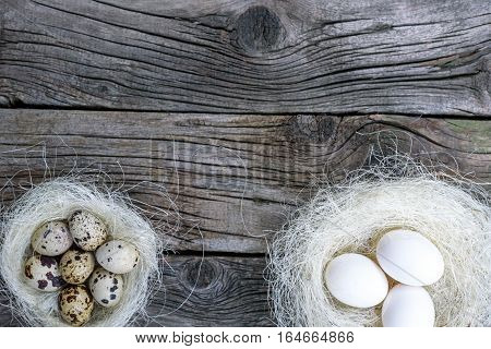 Easter Eggs In Nest Over Vintage Wood.