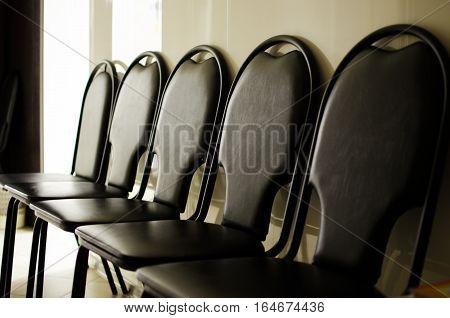 a Few empty chairs in the dark